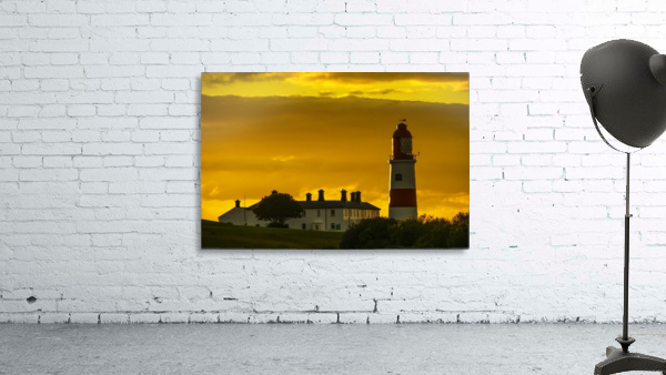 Souter Lighthouse under a glowing golden sky at sunset; South Shields, Tyne and Wear, England