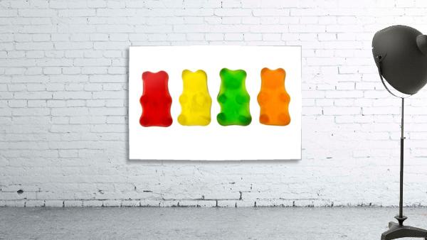 Colourful candied gummy bears in a row backlit; Calgary, Alberta, Canada