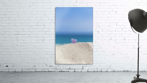 A lavender heart shaped sea glass in the sand at the beach; Honolulu, Oahu, Hawaii, United States of America