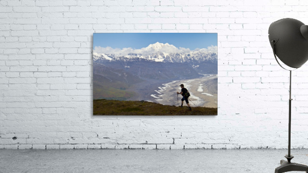 Silhouette Of A Man Hiking In The Tokosha Mountains Above The Tokositna Glacier With Mt. Hunter And The Alaska Range In The Background, Denali National Park & Preserve, Interior Alaska, Summer