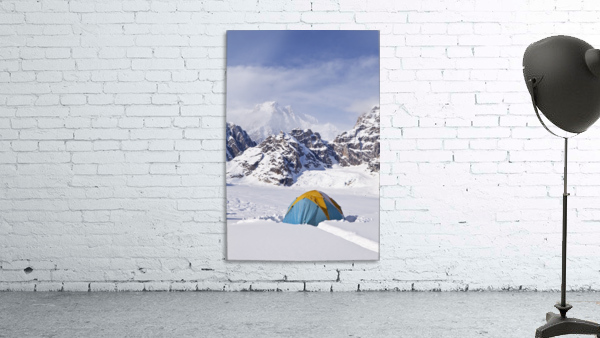 Mountain tent on ridge in winter, Mt. McKinley in background, part of Mt. Dan Beard immediately behind tent, Denali National Park and Preserve; Alaska, United States of America