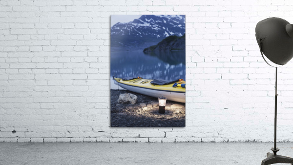 Kayak and lantern on the beach with mountains in the back ground at dusk, Shoup Bay State Marine Park, Prince William Sound, Valdez, Southcentral Alaska