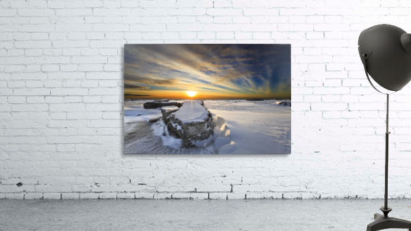 A large ice block on frozen Turnagain Arm at sunset; Anchorage, Alaska, United States of America