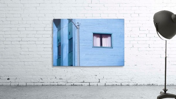 vintage blue wood building with window and electric pole