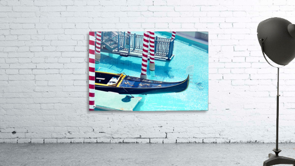 Classic Gondola boat and blue water