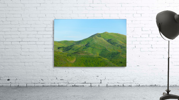 green field and green mountain with blue sky
