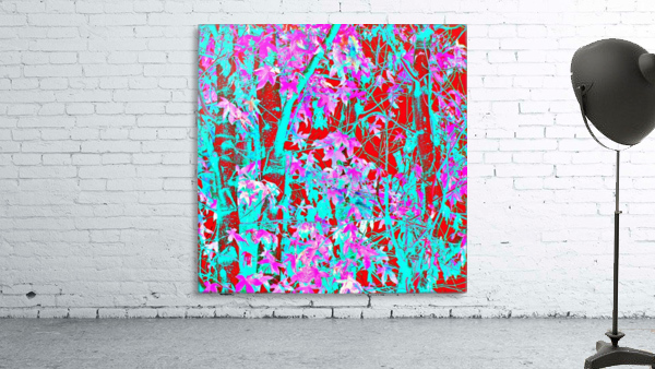 pink maple tree leaf with blue and red abstract background