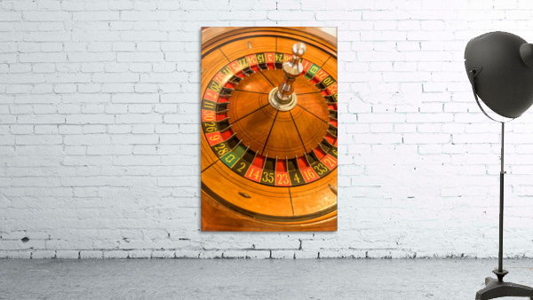 Round, wooden roulette wheel with numbers around the wheel