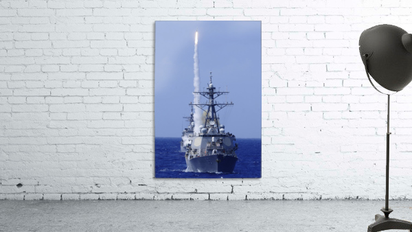 The guided-missile destroyer USS Benfold fires a surface-to-air missile off the coast of Hawaii.