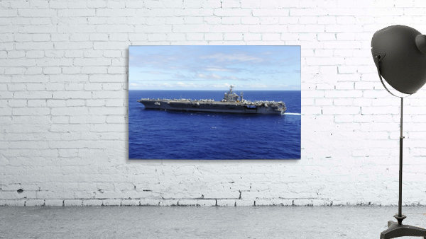The aircraft carrier USS Abraham Lincoln transits across the Pacific Ocean.