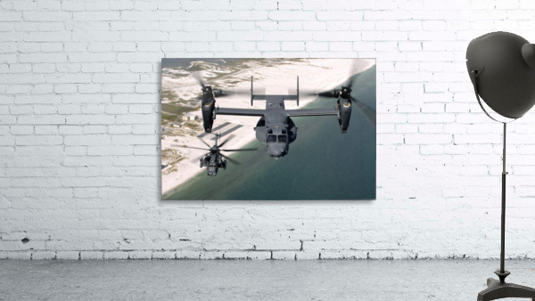 A CV-22 Osprey and an MH-53 Pave Low fly over the coastline of Florida.