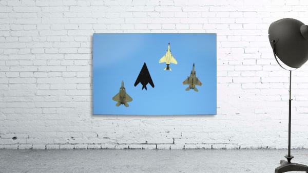 An F-22 Raptor an F-117 Nighthawk an F-4 Phantom and an F-15 Eagle in flight.