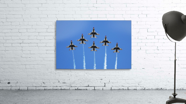 The U.S. Air Force Thunderbirds perform a 6-ship formation flyby during an air show.