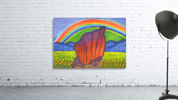 Mystical rock under the rainbow