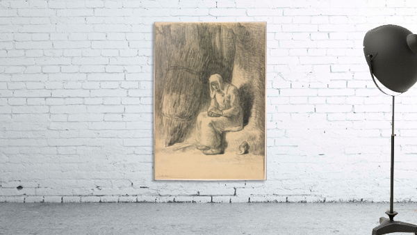 Woman seated beside a tree