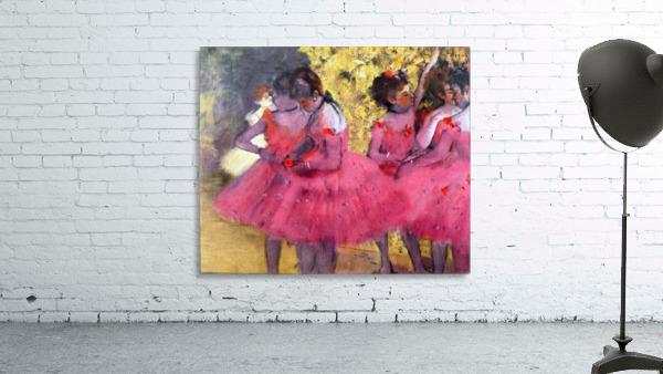Dancers in pink between the scenes by Degas