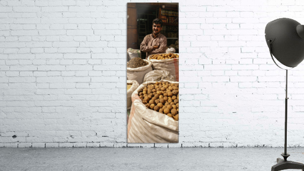 Shop keeper behind Bags of Dried goods
