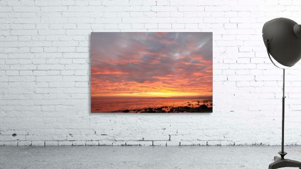 Dramatic sunset at a small bay