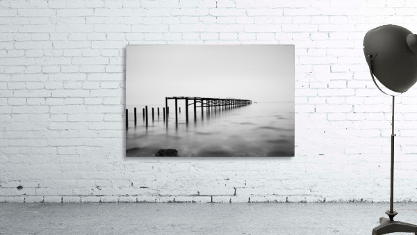 Abandoned pier in the sea at sunset