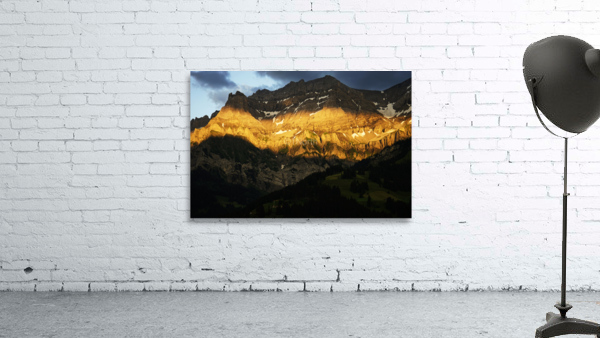 Mountain Bathed in the Golden Rays of the Sun at Sunset in Switzerland 2 of 3