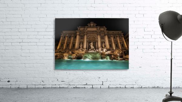 Trevi fountain illuminated at nighttime; Rome, Italy