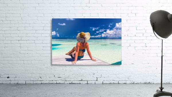 Sexy woman in bikini enjoy in tropical resort, sitting, back view