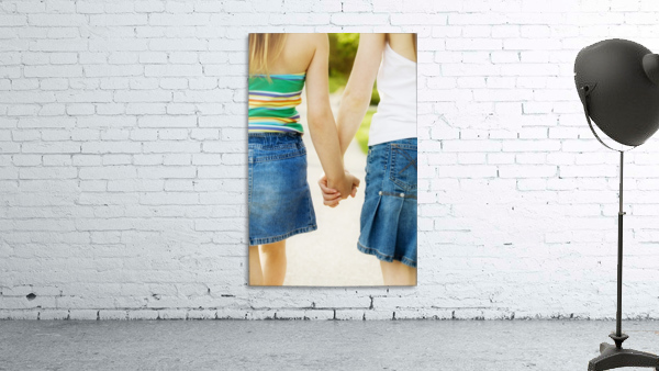 Rear View Of Girls Holding Hands