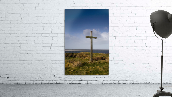 Grave Site Marked By A Cross On A Hill