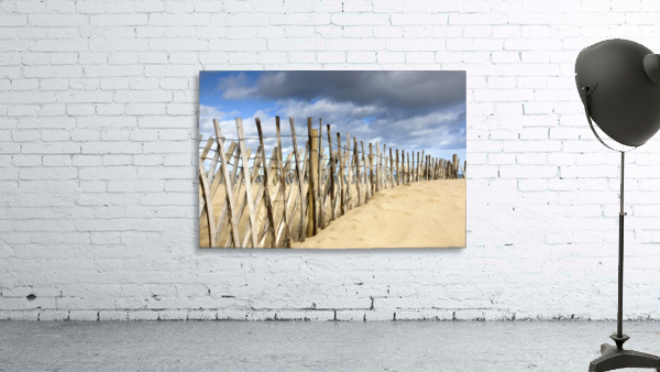 South Shields, Tyne And Wear, England; Dark Clouds Over Fence On A Beach