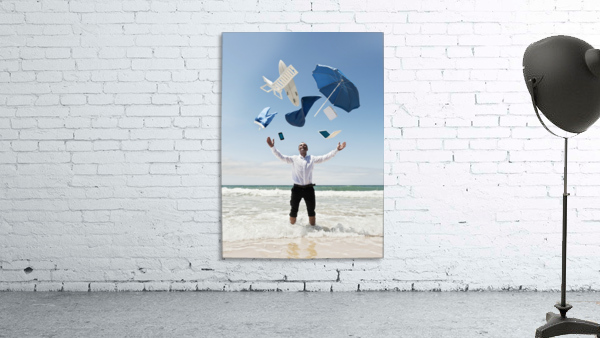 A Man Stands In The Ocean With Items From Work And Vacation Flying Over His Head; Tarifa, Cadiz, Andalusia, Spain
