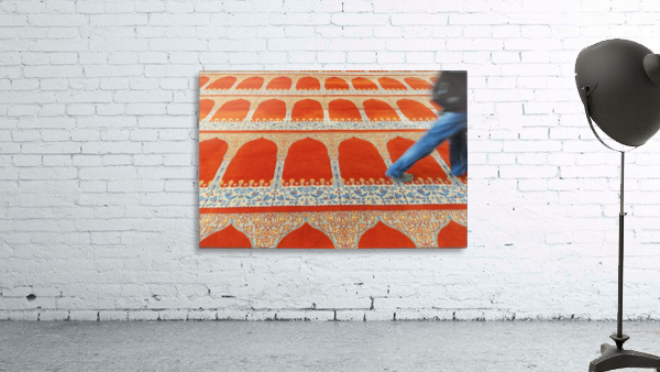 A person walking over the colourful carpet in the suleymaniye mosque;Istanbul turkey