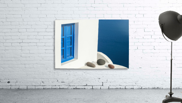 Whitewash building with blue trimmed window along the Aegean sea; Oia, Santorini, Greece