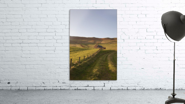 Northumberland, England; A Farm Structure And A Fence Around A Field