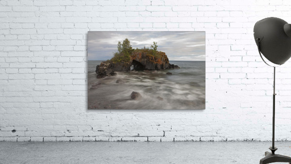 Water Coming Into Shore Around A Rock Formation On Lake Superior; Grand Portage, Minnesota, United States Of America