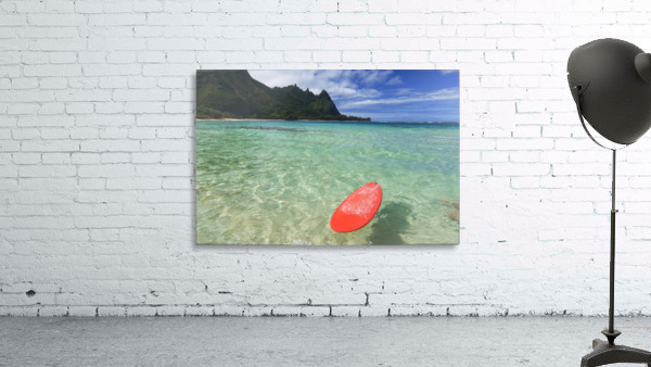 Hawaii, Kauai, Haena Beach Tunnels Beach, Red Surfboard Floating In Shallow Ocean.
