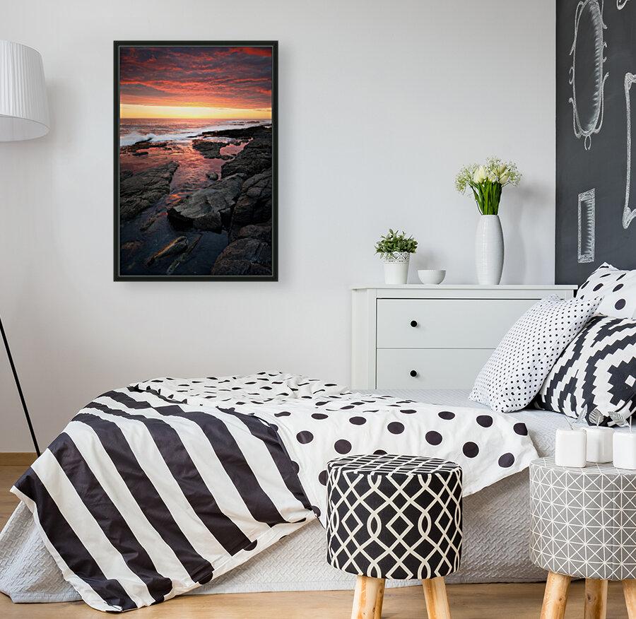 Sunset over rocky coastline  Art