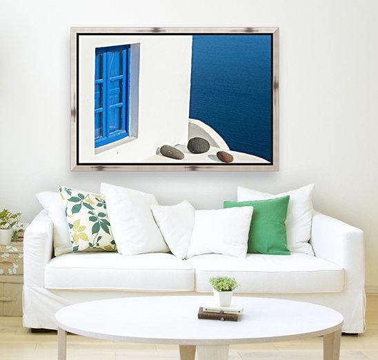 Whitewash building with blue trimmed window along the Aegean sea; Oia, Santorini, Greece  Art