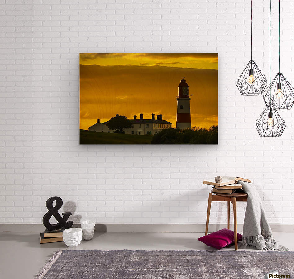 Souter Lighthouse under a glowing golden sky at sunset; South Shields, Tyne and Wear, England  Wood print