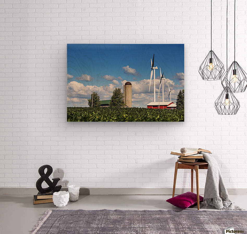 Large metal windmills in a farm yard with red barn and silo, soy bean field in the foreground and blue sky and clouds in the background; Ontario, Canada  Wood print