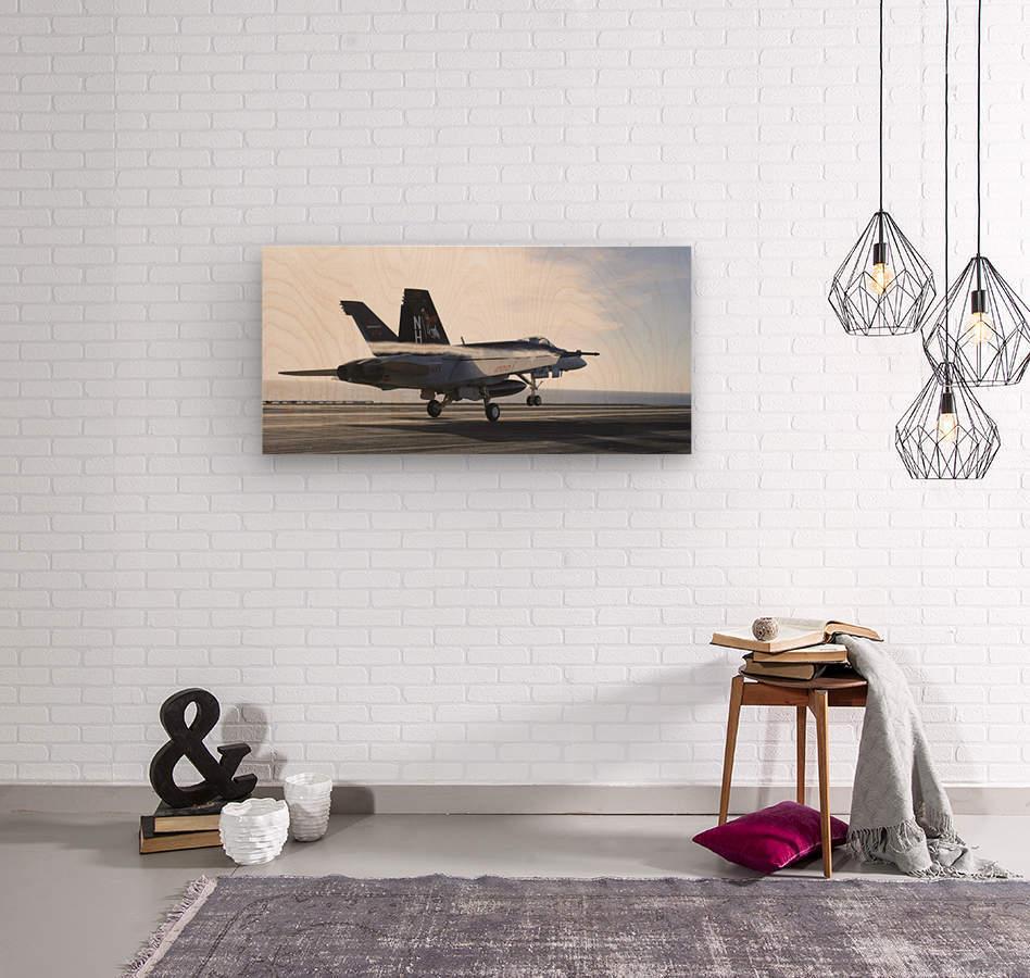 An F-A-18E Super Hornet touches the flight deck of USS Nimitz.  Wood print