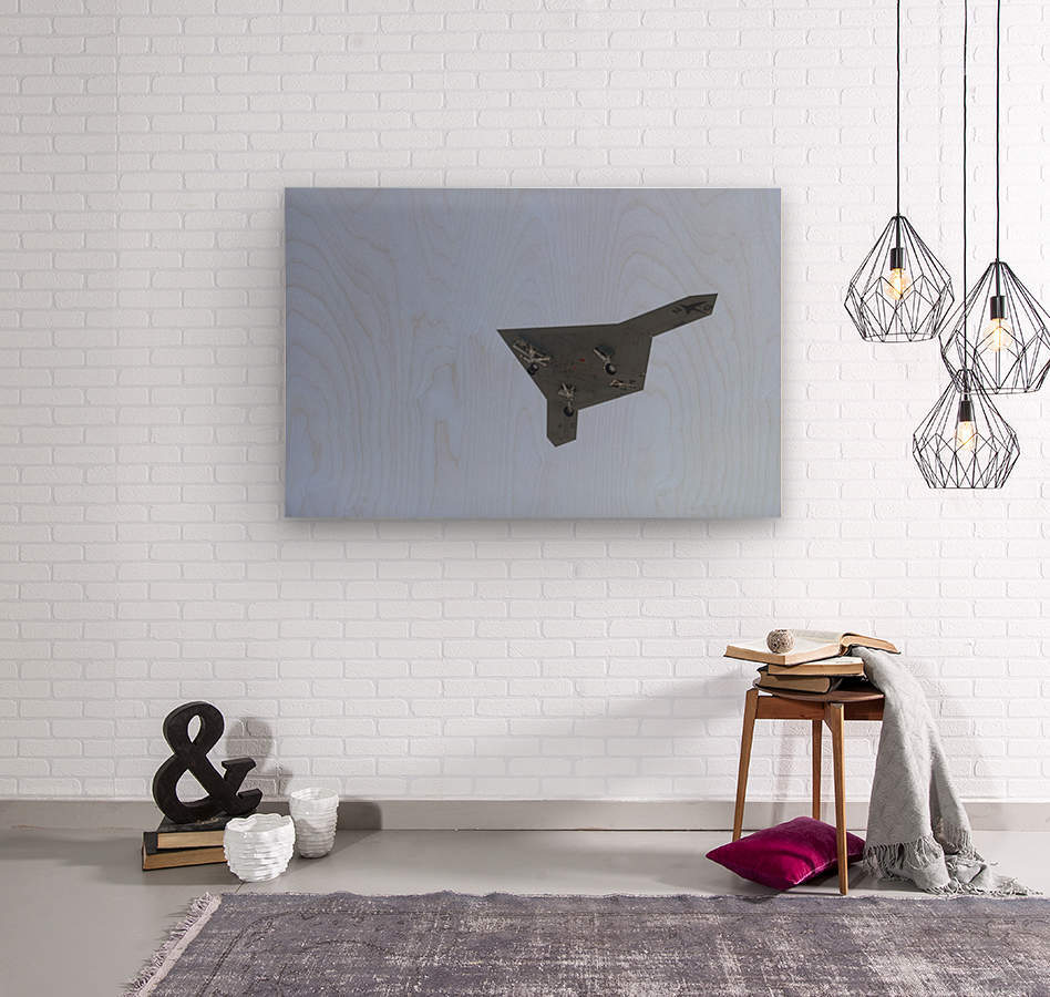 An X-47B unmanned combat air system in flight.  Wood print
