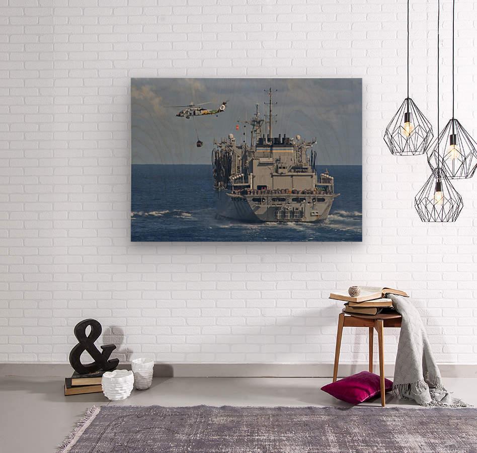 An MH-60S Sea Hawk conducts a vertical replenishment with USNS Bridge.  Wood print