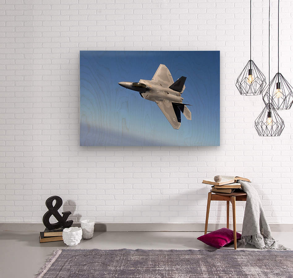 An F-A-22 Raptor banks during a training sortie.  Wood print