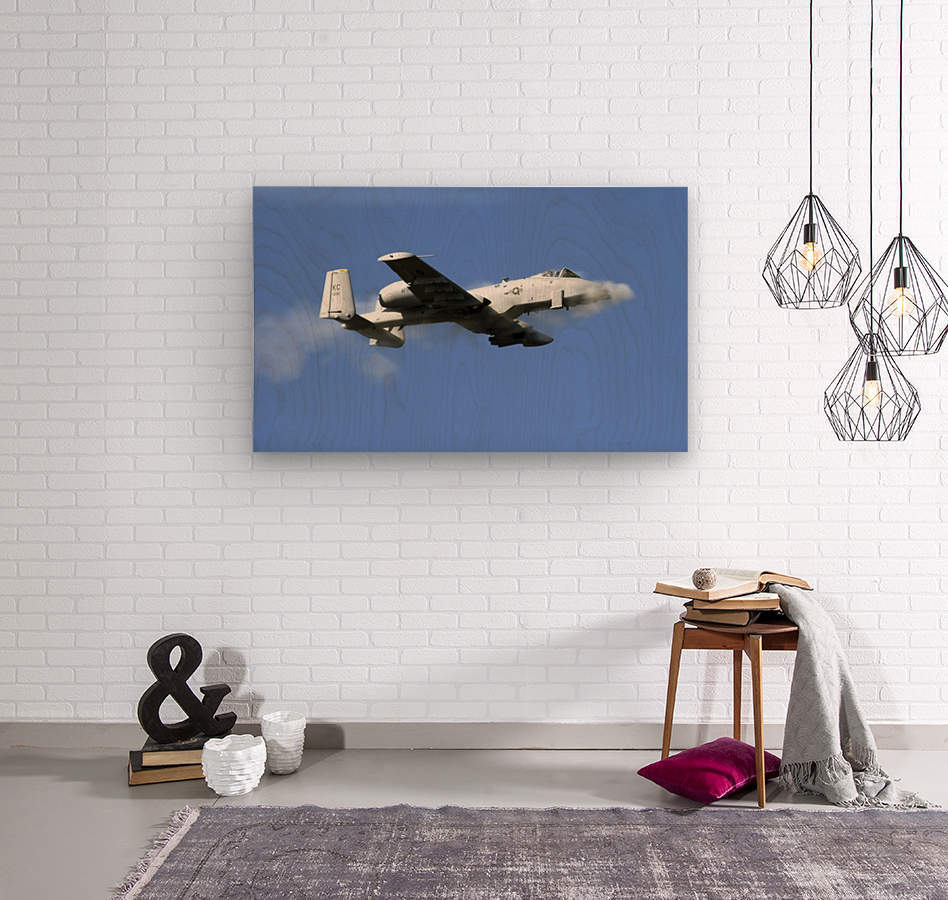 An A-10 Thunderbolt II pilot fires the planes 30-mm cannon.  Wood print