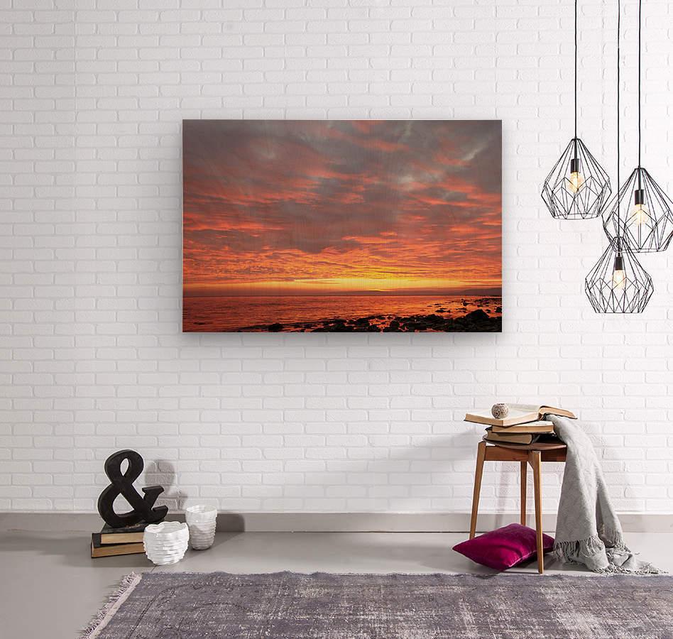 Dramatic sunset at a small bay  Wood print