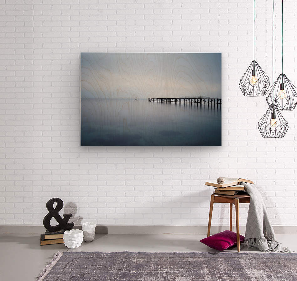 Abandoned pier in the sea at sunset  Wood print