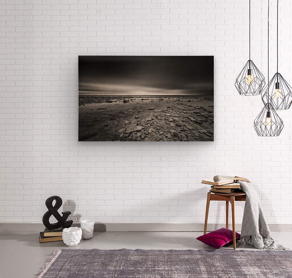 Dramatic sunset at a small bay and rocky beach  Wood print