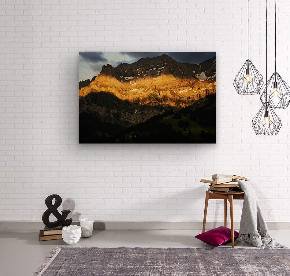 Mountain Bathed in the Golden Rays of the Sun at Sunset in Switzerland 2 of 3  Wood print