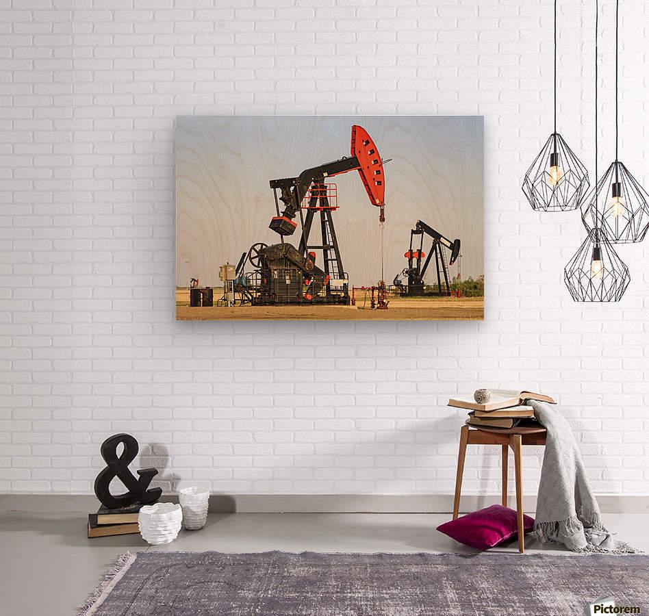 Oil well pump jacks at Bakken Oil Field near Estevan; Saskatchewan, Canada  Wood print