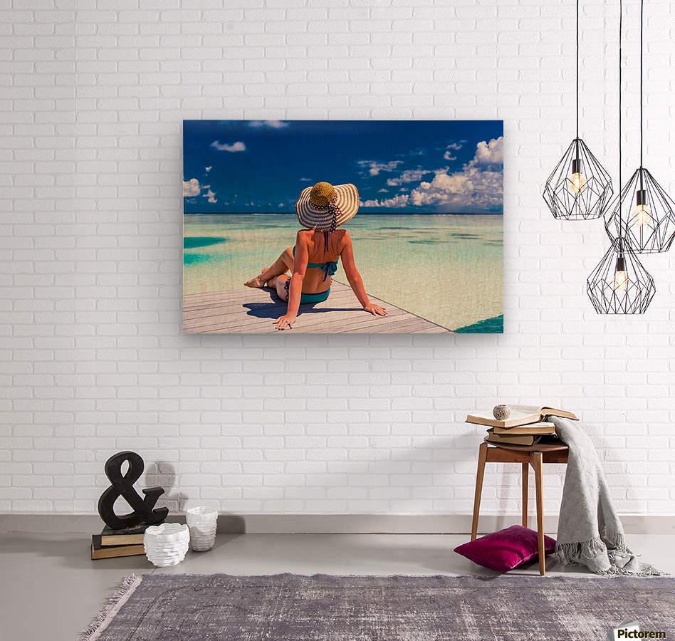 Sexy woman in bikini enjoy in tropical resort, sitting, back view  Wood print